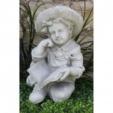 Sculpture Garçon avec livre résine effet pierre 45cm