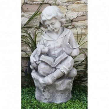 Sculpture Garçon avec livre résine effet pierre 63cm